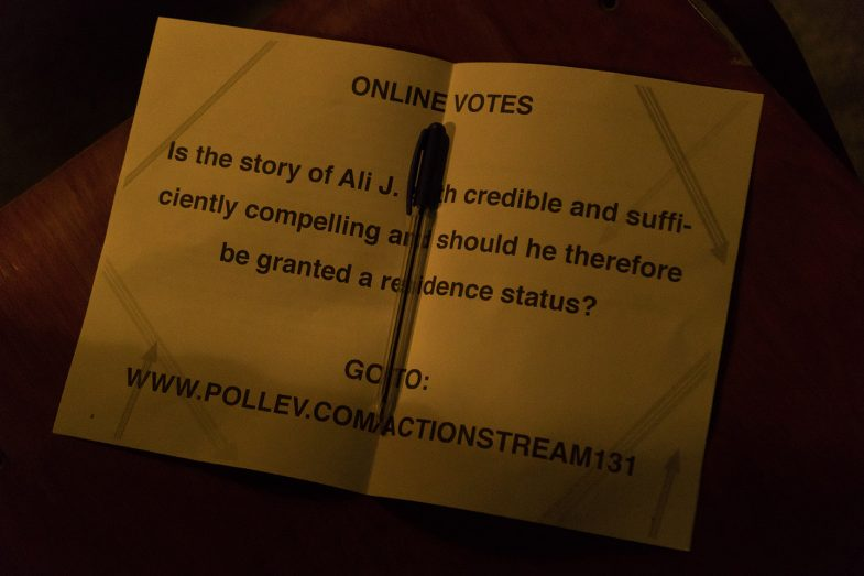 """Vote question in booklet of """"Refugee on Trial' performance art by Ehsan Fardjadniya"""