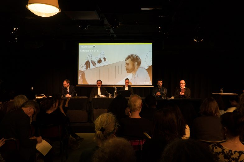 'Refugee on trial 'performance at Pakhuis de Zwijger Amsterdam 26 Nov. 2019. left to right. Frans William Verbaas(IND)-Teun van Os (Judge) Frederica van Straelen (clerk)Ehsan Fardjadniya(Artists, director-as Ali J)Hans van Zundert(Ali-J lawyer).