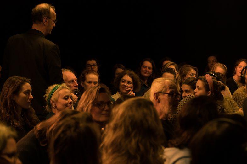 Marq Wijngaarden (modrator) takes public question at 'Refugee on Trial' performance art by Ehsan Fardjandiya