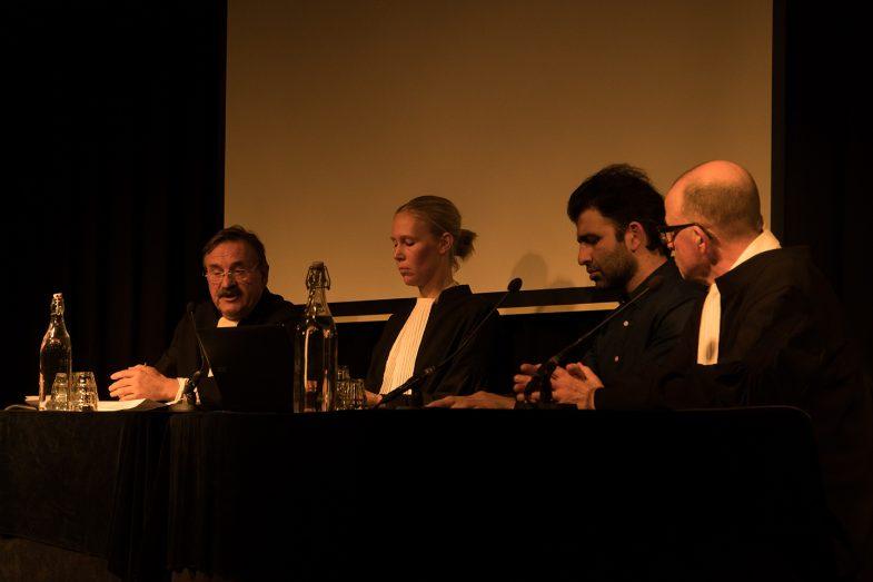 "Teun van OS (Judge), Frederike van Straele (Clerck), Ehsan Fardjadniya (Ali J), Hans van Zundert (Ali J lawyer) in ""Refugee on Trial"" performance art by Ehsan Fardjadniya at Pakhuis de Zwijger Amsterdam 26th Nov 2019."